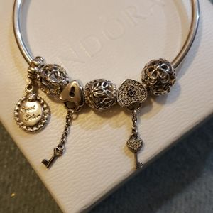 Authentic Pandora  Bangle bracelet and  Charms